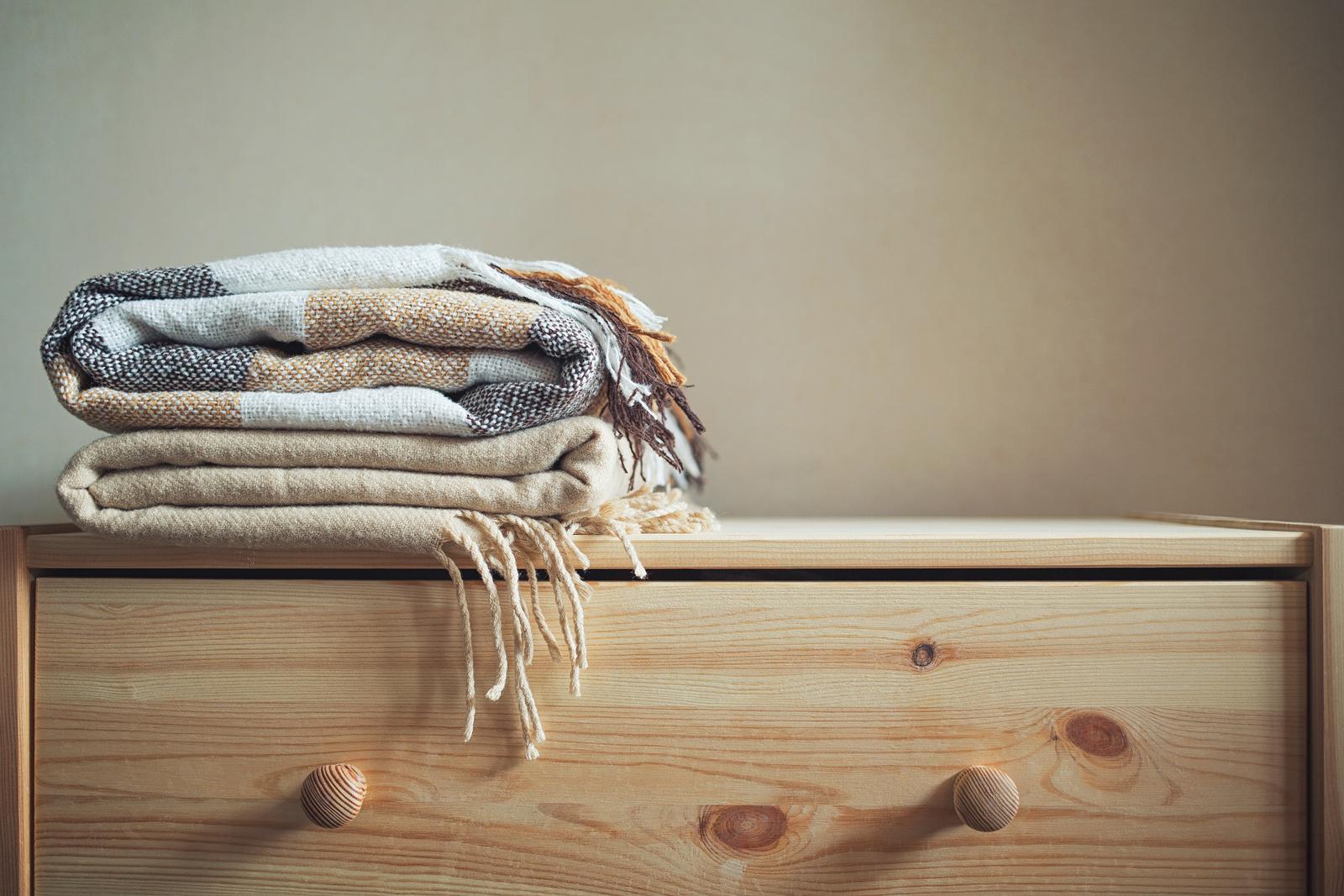 Onde e como guardar a roupa de cama no quarto