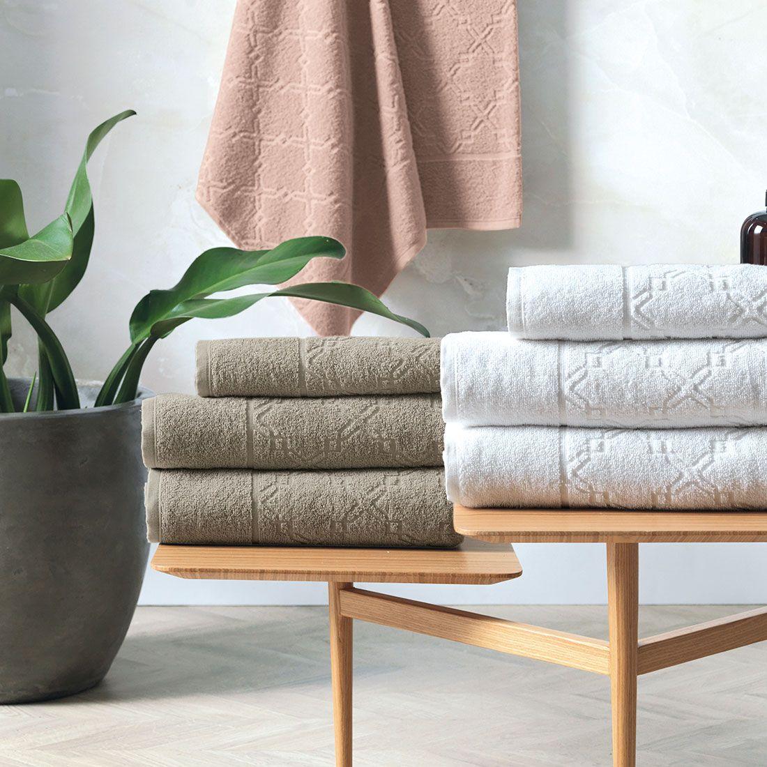 Aprenda como organizar toalhas de banho
